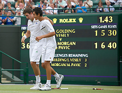 LONDON, ENGLAND - Sunday, July 3, 2011: Mate Pavic (CRO) (R) and George Morgan (GBR) (L) celebrate winning the Boys' Doubles Final match on day thirteen of the Wimbledon Lawn Tennis Championships at the All England Lawn Tennis and Croquet Club. (Pic by David Rawcliffe/Propaganda)