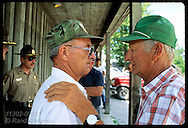One farmer consoles other w/ hand on shoulder as they brace for flood on 8/4/93;Prairie du Rochr Illinois