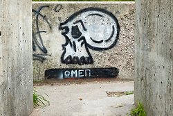 Graffiti depicting a skull with the word 'OMEN' inscribed beneath it on a stretch of the Trans Pennine Trail thats runs between Ecclesfield and Chapeltown.