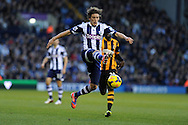 West Brom's Billy Jones controls the ball.  Barclays Premier league, West Bromwich Albion v Hull city at the Hawthorns in West Bromwich, England on Saturday 21st Dec 2013. pic by Andrew Orchard, Andrew Orchard sports photography.