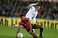Roque Mesa of Swansea city challenges Marcus Rashford of Manchester Utd .EFL Carabao Cup 4th round match, Swansea city v Manchester Utd at the Liberty Stadium in Swansea, South Wales on Tuesday 24th October 2017.<br /> pic by  Andrew Orchard, Andrew Orchard sports photography.