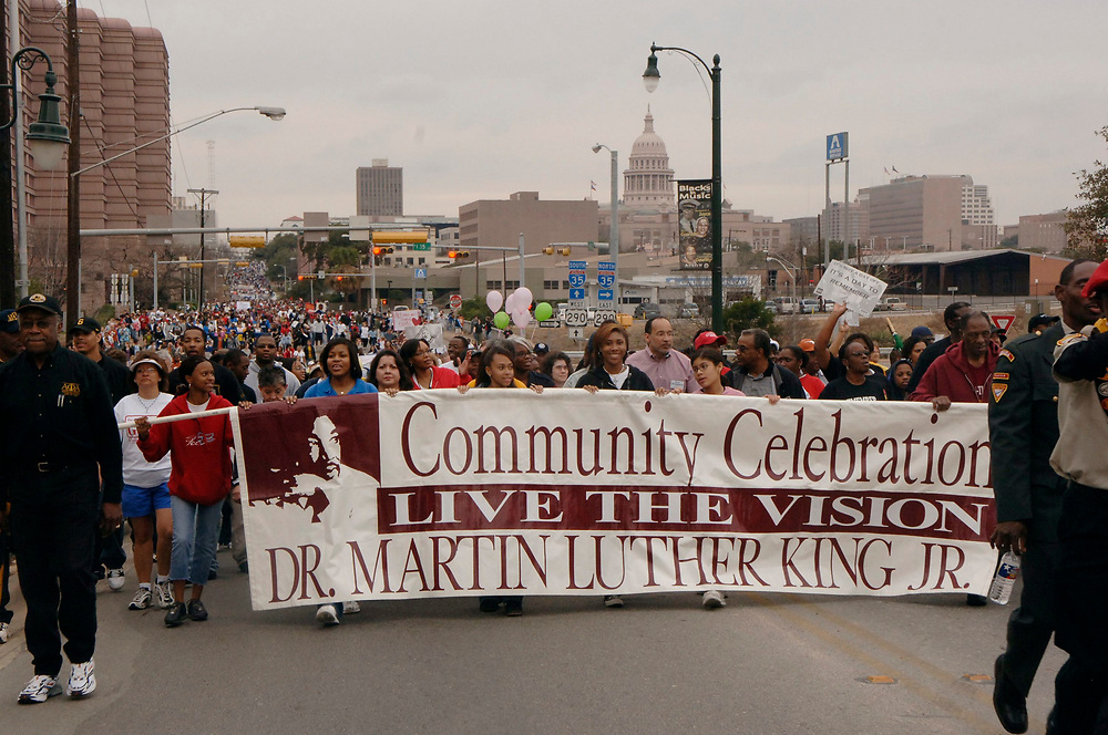 Marchers walk from Texas Capitol to historically black Huston Tillotson University during Martin Luther King Jr. Day celebration, Austin, TX. ©Janis Daemmrich