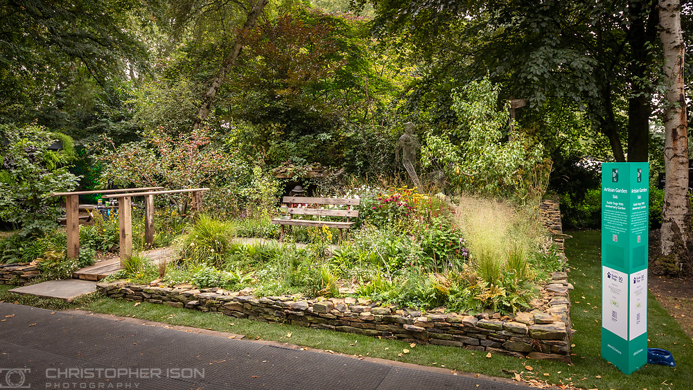 A view of the Artisan Garden designed by Jonathan Smith and Adam Woolcott at RHS Chelsea which they created this year in celebration of 90 years of guide dog partnerships in Britain. <br /> Picture date: Monday September 20, 2021.<br /> Photograph by Christopher Ison ©<br /> 07544044177<br /> chris@christopherison.com<br /> www.christopherison.com