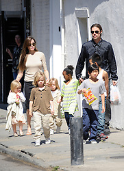 Brad Pitt and Angelina Jolie go for a walk with their six children Maddox, Pax, Zahara, Shiloh, Knox, and Vivienne in their neighborhood in New Orleans, LA, USA on March 20, 2011. Photo by Mehdi Taamallah/ABACAPRESS.COM  | 268010_003 New Orleans Nouvelle Orleans Etats-Unis United States