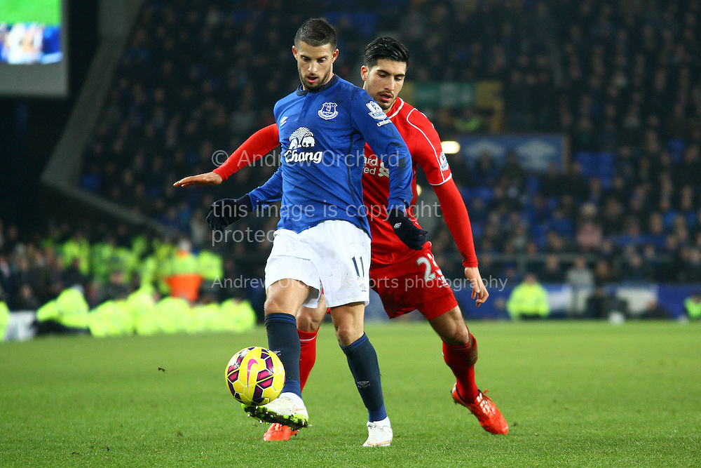 Kevin Mirallas of Everton under pressure from Emre Can of Liverpool. Barclays Premier league match, Everton v Liverpool at Goodison Park in Liverpool, Merseyside on Saturday 7th February 2015<br /> pic by Chris Stading, Andrew Orchard sports photography.