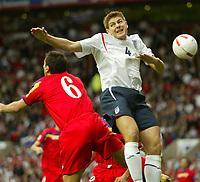 Photo: Aidan Ellis.<br /> England v Andorra. European Championships 2008 Qualifying. 02/09/2006.<br /> England's Steven Gerrard battles with Andorra's Antonio Sivera
