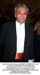 Multi-millionaire businessman ROBERT TCHENGUIZ at a ball in London on 22nd November 2003.POU 270