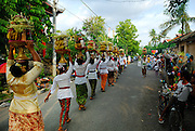 Women carrying offerings to the village temple as part of the celebration of Galungan. Galungan celebrates the victory of virtue (Dharma) over evil (Adharma) and is perhaps the most important religious holiday for Balinese Hindus. Sanur, Bali, Indonesia