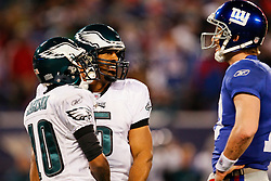 Philadelphia Eagles quarterback Donovan McNabb #5 speaks with New York Giants quarterback Eli Manning #10 during the NFL game between the Philadelphia Eagles and the New York Giants on December 13th 2009. The Eagles won 45-38 at Giants Stadium in East Rutherford, New Jersey. (Photo By Brian Garfinkel)