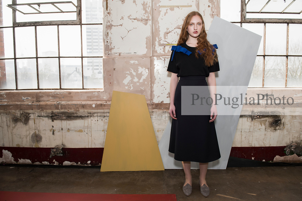 "London 18 February 2017, Edeline Lee Autumn Winter presentation at Oxo Tower during London Fashion Week AW17. Canadian-born, London-based EDELINE LEE graduated with a First from Central Saint Martins Womenswear and apprenticed in the studios of Alexander McQueen and John Galliano before working at Zac Posen in New York and as Head Designer for Rodnik in London. An unintentional soft launch led to a flurry of private orders and the birth of her eponymous collection in 2014. The designer has stated that she designs for the ""Future Lady"": her work has been worn by stars like Alicia Vikander, Taylor Swift, Holland Roden and Solange Knowles. She has also received strong support from the women of the art world, who naturally gravitate towards her aesthetically sophisticated signature. <br />  <br /> Edeline Lee has been awarded support by the Centre for Fashion Enterprise and has been two times Finalist for the Samsung Fashion & Design Fund. Her work was recently exhibited by the curators of the Fashion Space Gallery to represent the ""Future of Fashion Presentation"". She is currently nominated for Breakthrough Womenswear Designer of the Year at the WGSN Fashion Futures Awards. <br />  <br /> Spring Summer 2016 was her debut season on the official London Fashion Week schedule of the British Fashion Council. All Edeline Lee pieces are made of the finest French and Italian cloths, by hand in England."