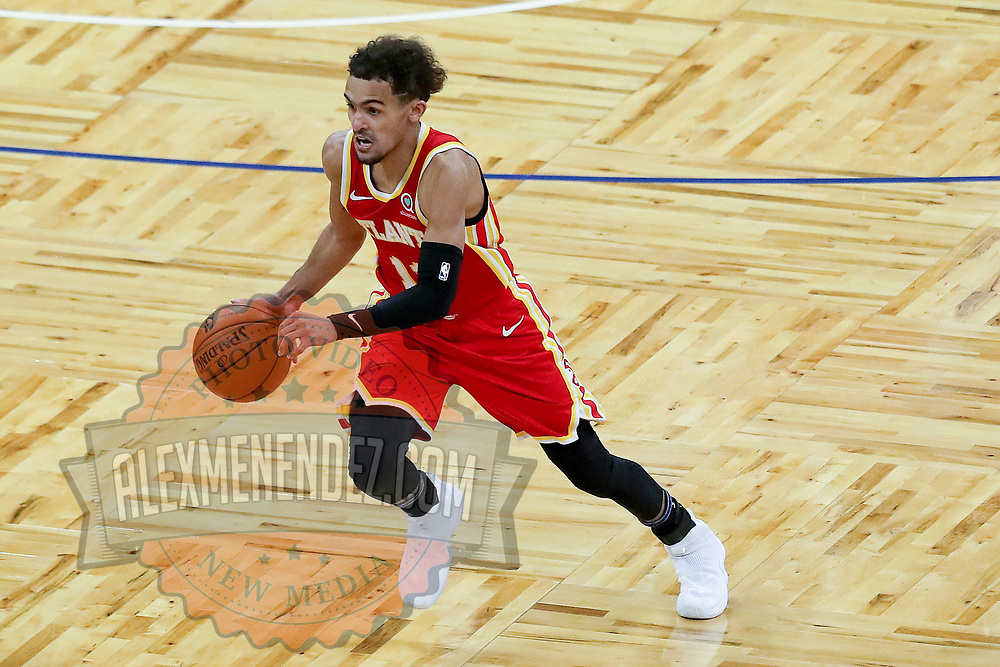 ORLANDO, FL - MARCH 03: Trae Young #11 of the Atlanta Hawks controls the ball against the Orlando Magic at Amway Center on March 3, 2021 in Orlando, Florida. NOTE TO USER: User expressly acknowledges and agrees that, by downloading and or using this photograph, User is consenting to the terms and conditions of the Getty Images License Agreement. (Photo by Alex Menendez/Getty Images)*** Local Caption ***Trae Young