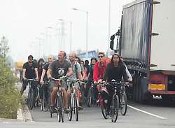 """© Licensed to London News Pictures. 30/08/2015. Calais, France. Around a hundred British cyclists from """"Critical mass to Calais"""" arrive to Calais from London as they are to donate bicycles to the people in the refugee camp, also known as the Jungle, as well as supplies to support the life at the site. Photo credit : Isabel Infantes/LNP"""