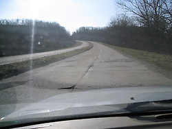 4 Lanes of remaining Portland Cement along Route 66 near Devils Elbow, MO as seen from a moving car. This is one of the last remaining historic 1940's alignments of US 66 in Missouri.