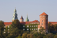 late afternoon sunlight falls on the wawel castle in krakow poland. sigismund tower can be seen to the right