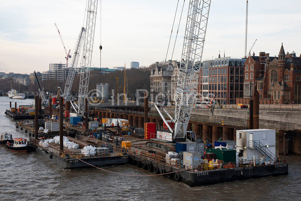Construction work underway on the Thames Tideway Tunnel or Super Sewer alongside Blackfriars Bridge on the River Thames in London, England, United Kingdom. The Thames Tideway Tunnel is an under-construction civil engineering project 25 km tunnel running mostly under the tidal section of the River Thames through central London, which will provide capture, storage and conveyance of almost all the combined raw sewage and rainwater discharges that currently overflow into the river.
