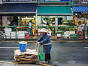 27 DECEMBER 2015 - SINGAPORE, SINGAPORE:   A Singaporean woman recycles cardboard near Tekka Market. First opened in 1915, the market was moved to its present location in 1982 and renovated in 2009. It is one of the most famous hawker stall (street food) areas in Singapore.      PHOTO BY JACK KURTZ