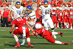 29 October 2016:  Dallas Goedert gets caught byAlejandro Rivera and Brannon Barry. NCAA FCS Football game between South Dakota State Jackrabbits and Illinois State Redbirds at Hancock Stadium in Normal IL (Photo by Alan Look)