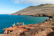 Tourists on the island of Rabida (off the coast of Santiago). This island is famous for it's red lava sand.
