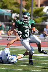 17 September 2011: T.J. Stinde escapes the grasp of Dan Maxwell during an NCAA Division 3 football game between the Aurora Spartans and the Illinois Wesleyan Titans on Wilder Field inside Tucci Stadium in.Bloomington Illinois.