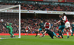 Arsenal's Danny Welbeck (second right) scores his team's third goal of the game