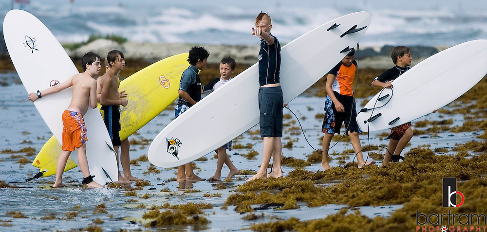 KEVIN BARTRAM/The Daily News.Surf camp instructor Milby Shannon directs campers on the beach near 28th Street and Seawall Boulevard during the Ohana Surf Camp on Tuesday, July 19, 2005.