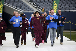 January 2, 2018 - Chicago, IL, USA - Oshua Martinez, 15, carries the torch before lighting the cauldron during the opening ceremony for the 48th annual Special Olympics Chicago spring games on April 29, 2016. (Credit Image: © Armando L. Sanchez/TNS via ZUMA Wire)