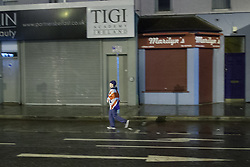 "© Licensed to London News Pictures . 11/01/2013 . Belfast , UK . A boy wrapped in a Union flag walks towards the road block at a Loyalist protesters in Castlereagh , East Belfast , where protesters block major routes in and out of Belfast as part of "" Operation Standstill "" today (11th January 2013) . The protest is one of many that have been held since Belfast City Council voted to stop flying the Union flag above Belfast City Hall . Photo credit : Joel Goodman/LNP."