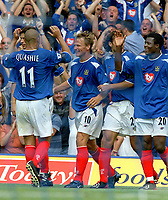 Teddy Sheringham (Portsmouth) celebrates with team mates after scoring goal no 1.  Portsmouth v Aston Villa. 16/8/2003. Credit : Colorsport/Andrew Cowie.