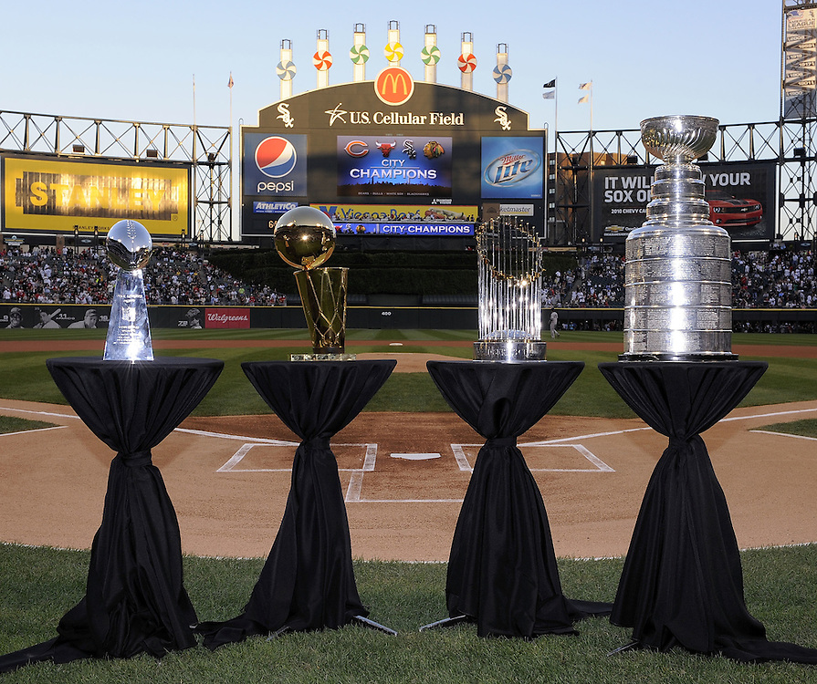 CHICAGO - AUGUST 27:  Left to right: The NFL Lombardi trophy, NBA trophy, the World Series trophy and the Stanley Cup were displayed together prior to the game between the Chicago White Sox and New York Yankees on August 27, 2010 at U.S. Cellular Field in Chicago, Illinois.  Chicago is the only city to earn all four major trophies in the last 25 years.  The White Sox defeated the Yankees 9-4.  (Photo by Ron Vesely)