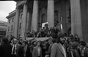 Sinn Fein (Provo) Dublin Parade.   K22..1976..25.04.1976..04.25.1976..25th April 1976..Sinn Fein held an Easter Rising Commemorative  parade..The parade started at St Stephens Green, Dublin and proceeded through the streets to the G.P.O.in O'Connell Street, the scene of the centre of the 1916 uprising..Pictured,the vanguard of the parade takes up position at the front of the viewing rostrum at the G.P.O.(General Post Office)