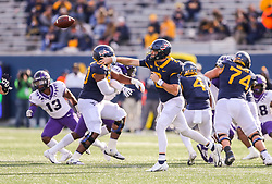 Nov 14, 2020; Morgantown, West Virginia, USA; West Virginia Mountaineers quarterback Jarret Doege (2) throws a pass during the third quarter against the TCU Horned Frogs at Mountaineer Field at Milan Puskar Stadium. Mandatory Credit: Ben Queen-USA TODAY Sports