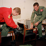 New first year pilots of the Red Arrows, Britain's RAF aerobatic team try on their new red flying suits for size.