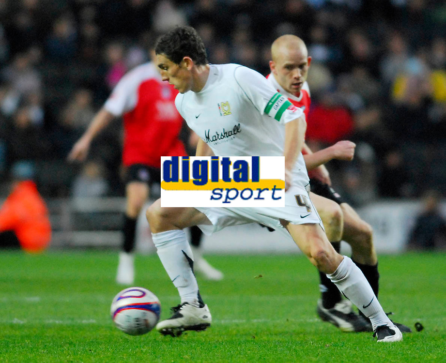 Photo: Leigh Quinnell/Sportsbeat Images.<br /> Milton Keynes Dons v Chesterfield. Coca Cola League 2. 24/11/2007. MK Dons Keith Andrews takes the ball away from Chesterfields Derek Niven.
