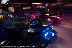 Police on their Victory Police Bikes ride Main Street on the first Saturday night during Daytona Bike Week. Saturday, March 7, 2015.  Photography ©2015 Michael Lichter.
