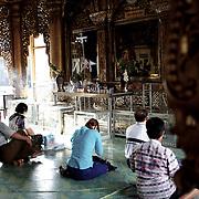 May 09, 2013 - Yangon, Myanmar: Buddhist devotees pray at Sule Pagoda in central Yangon. (Paulo Nunes dos Santos/Polaris)