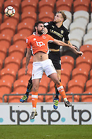 Blackpool's Clark Robertson competes in the air with Barnsley's Marc Roberts<br /> <br /> Photographer Richard Martin-Roberts/CameraSport<br /> <br /> Emirates FA Cup Third Round - Blackpool v Barnsley - Saturday 7th January 2017 - Bloomfield Road - Blackpool<br />  <br /> World Copyright © 2017 CameraSport. All rights reserved. 43 Linden Ave. Countesthorpe. Leicester. England. LE8 5PG - Tel: +44 (0) 116 277 4147 - admin@camerasport.com - www.camerasport.com