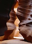 Convoluted entrance into a slot canyon of the Colorado Plateau.