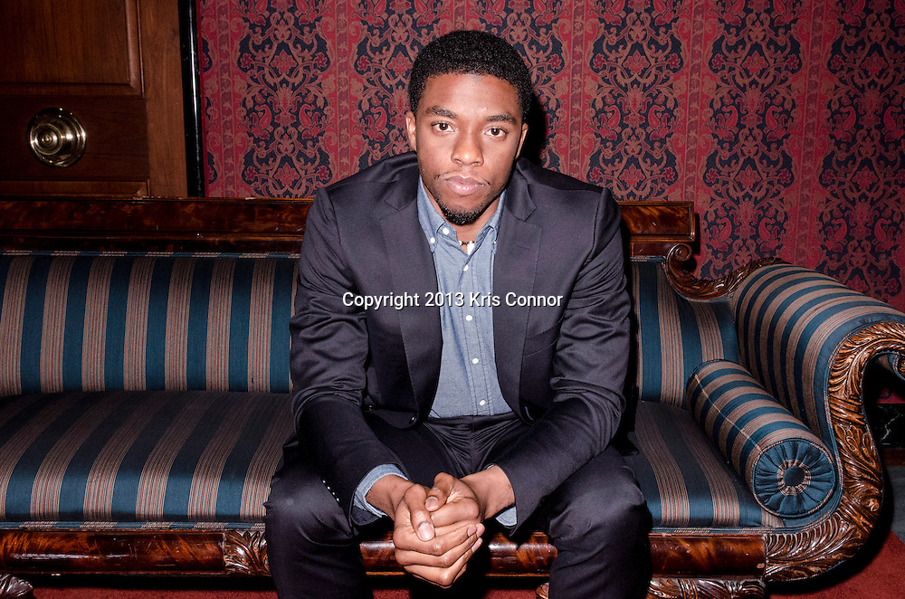 """WASHINGTON, DC - APRIL 15:  Actor Chadwick Boseman, poses for a photo during the Washington DC screening of Warner Bro's film """"42"""" at Smithsonian Museum of American History on April 15th, 2013. Guests included star of the film Chadwick Boseman, John Gray, Carol Melton, and Lonnie Bunch. Photo by Kris Connor/Warner Bros"""