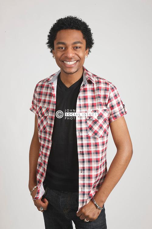 Studio portrait of black young man.