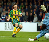 Photograph:Scott Heavey.<br />Gillingham v West Bromwich Albion. Nationwide Duvision one. 04/10/2003.<br />Scott Dobie makes it 0-1 to the Baggies