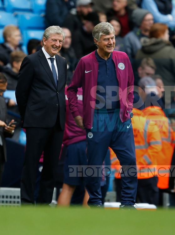 Roy Hodgson manager of Crystal Palace with Brian kidd before the start of the premier league match at the Etihad Stadium, Manchester. Picture date 22nd September 2017. Picture credit should read: Simon Bellis/Sportimage