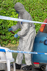 © Licensed to London News Pictures. 21/05/2020. Beaconsfield, UK. A forensic investigator holds a screwdriver type tool recovered from underneath a vehicle parked inside a cordon at a property on North Drive in Beaconsfield. Thames Valley Police were called to North Drive, Beaconsfield at around 00:01 BST on Thursday 21/05/2020 to a report of a stabbing. A man in his forties had sustained injuries consistent with stab wounds and was taken to hospital. Photo credit: Peter Manning/LNP