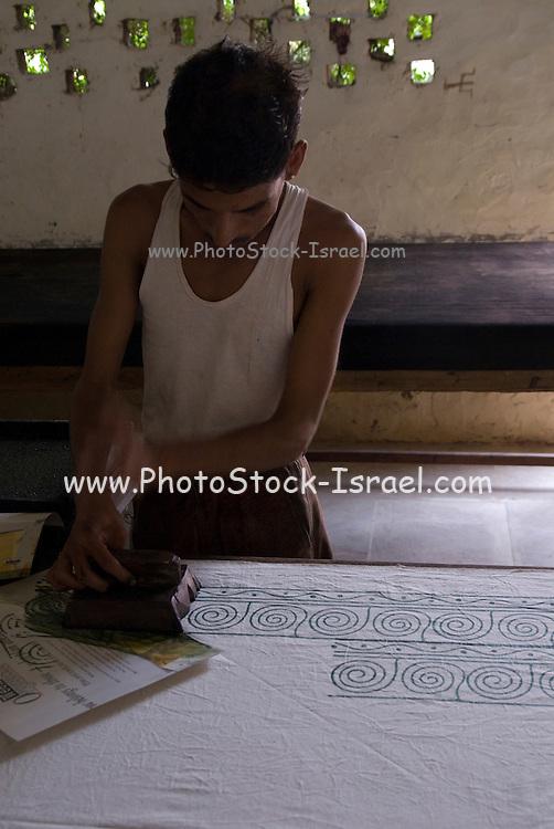 India, Rajasthan, Pushkar, Block-printing involves printing of cloth with carved wooden blocks.
