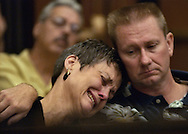 """Chris Wrolstad, left, cries on the shoulder of her husband, Jim Wrolstad, right, after delivering an extremely emotional """"victim impact"""" statement during the sentencing of Correll Hicks Jr. for the murder of her daughter, Jessica Smith in a domestic violence incident in September, 2002.  In the background is Rick Smith, the father of Jessica Smith who also gave an emotional statement in court.  Hicks Jr. was sentenced to 26 years to life  in prison for the murder.  The statements the family gave, including ones by Jessica's brother and a cousin, provided a glimpse into grief an extended family experiences long after a domestic violence crime is committed.  The sentencing took place in the courtroom of Judge Michael Garcia in Sacramento Superior Court, Friday, September 10, 2004."""