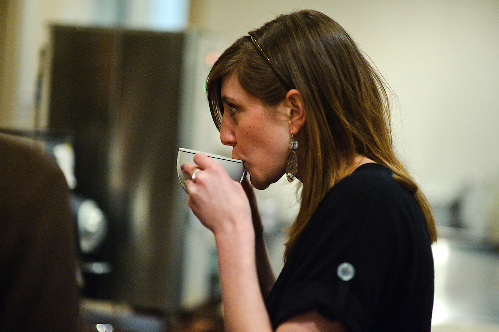 (staff photo by Matt Roth)..Spro employee Jess Carmer sips on a latte she made during the soon-to-be-opened coffee shop's day-long Barista Jam Saturday, February 13, 2010. The Jam brought in coffee specialists from around the country to teach alternative coffee brewing methods, latte art techniques, and coffee cuppingns -- similar to wine tastings -- were also held.