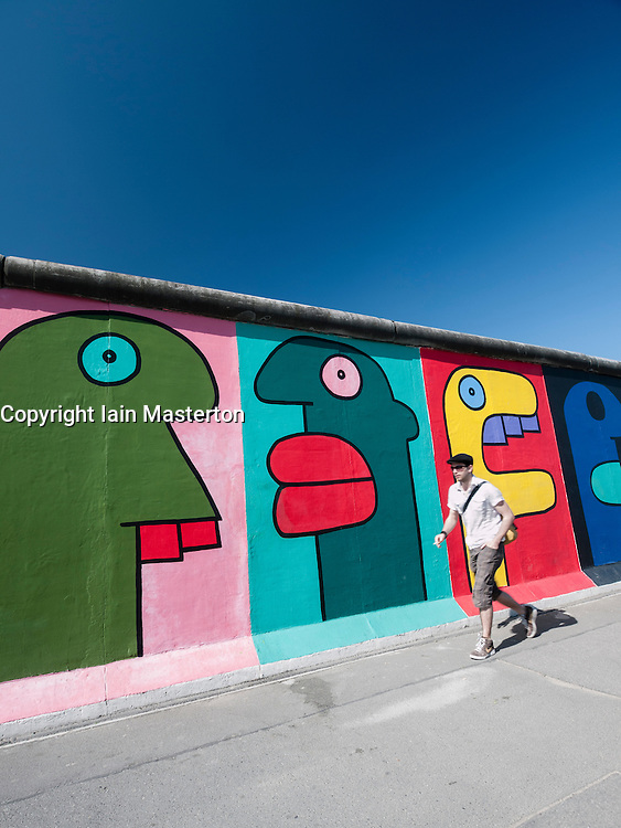 colourful mural painted on wall at East Side Gallery at former Berlin Wall in Friedrichshain/Kreuzberg in Berlin Germany