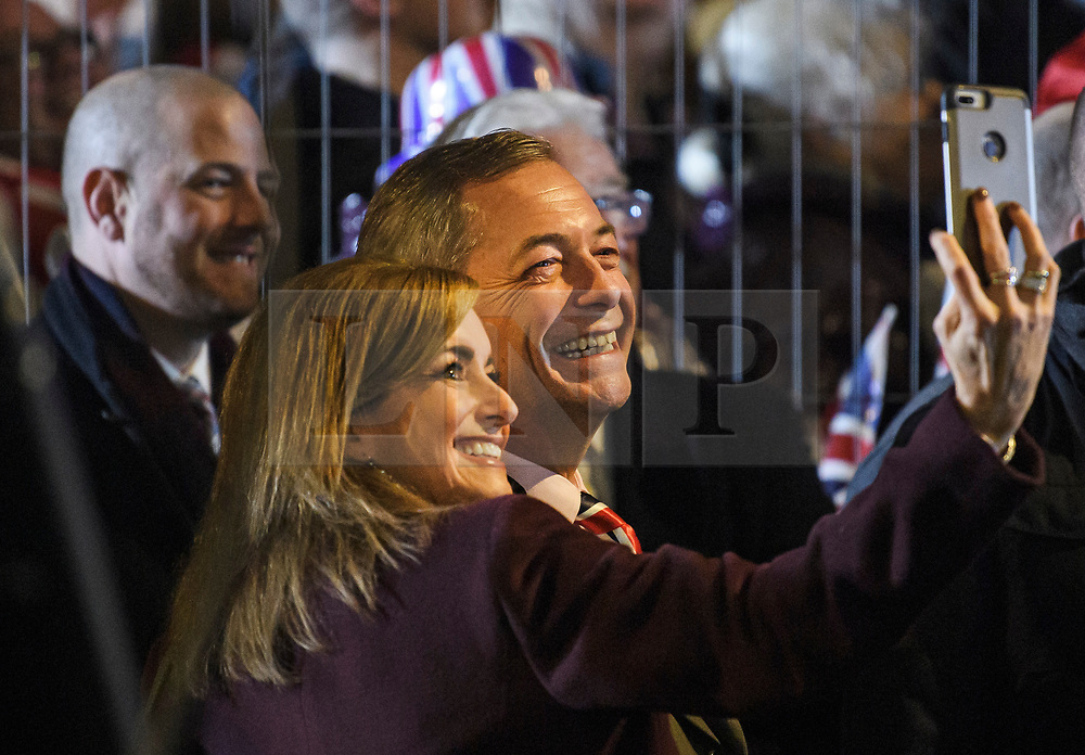 © Licensed to London News Pictures. 31/01/2020. London, UK. Brexit Party leader NIGEL FARAGE is seen posing for a selfie with a young fan as supporters of Brexit celebrate in Westminster, London, on the day that the UK leaves the European Union. 51.9% of the UK population voted to leave the EU in a referendum in June 2016. Photo credit: Ben Cawthra/LNP