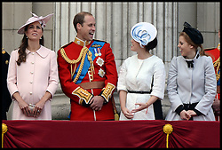 Prince William Shares a joke with Princesses Beatrice and Eugenie on the Balcony of Buckingham Palace during Trooping The Colour, London, United Kingdom,<br /> Saturday, 15th June 2013<br /> Picture by Andrew Parsons / i-Images