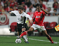 Photo: Lee Earle.<br /> Benfica v Manchester United. UEFA Champions League, Group F. 26/09/2006. United's Gabriel Heinze (L) battles with Paulo Jorge.