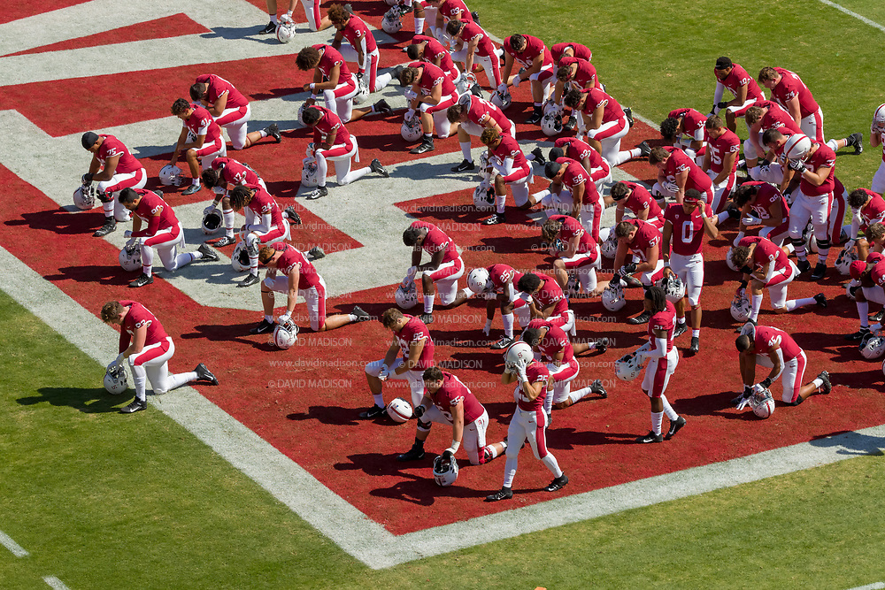 PALO ALTO, CA - OCTOBER 2:  Members of the Stanford Cardinal football team kneel on the field prior to  a Pac-12 football game against the Oregon Ducks on October 2, 2021 at Stanford Stadium in Palo Alto, California.  (Photo by David Madison/Getty Images)